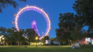 istock low angle view: observation wheel in Prater Park  of Vienna at twilight, Austria 1207753093
