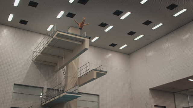 Low angle view of athlete diving in training center