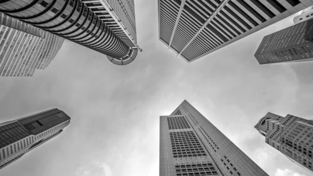 low angle view of banks and commercial buildings in central business district - black and white architecture stock videos & royalty-free footage