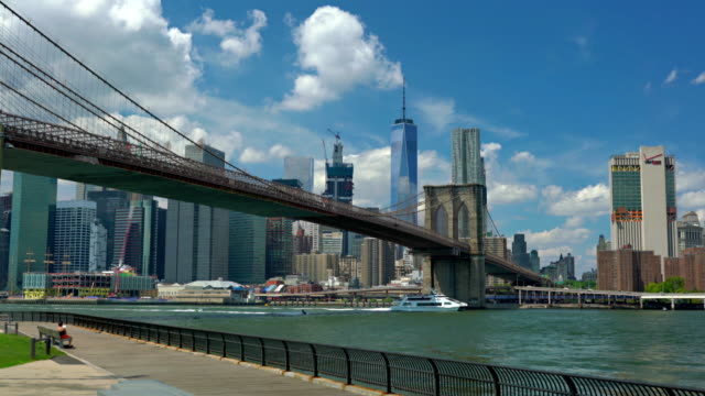 Low Angle View Of Brooklyn Bridge Over East River By Cityscape Against Sky video
