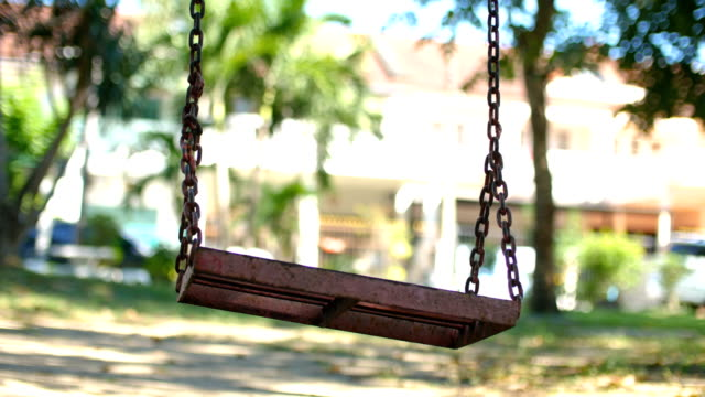 Low Angle View of Empty Swing in Park Low Angle View of Empty Swing in Park swinging stock videos & royalty-free footage