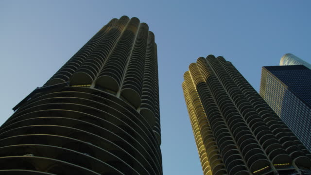 Low angle view of Marina City Low angle view of Marina City in Chicago, USA. chicago architecture stock videos & royalty-free footage