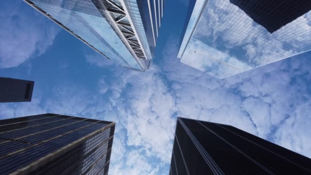 low angle view of modern office buildings - new york architecture stock videos & royalty-free footage