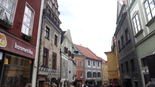 low angle view while walking along the market and shopping street in Cesky Krumlov town