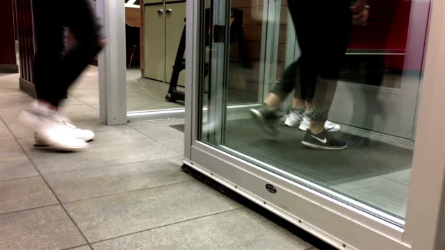 Low angle with people foot walking through the doors video