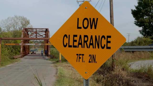 low clearance sign at route 66 bridge in sapulpa - road signs stock videos and b-roll footage
