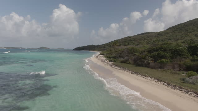 Low drone shot following the beach line in the Grenadines. video