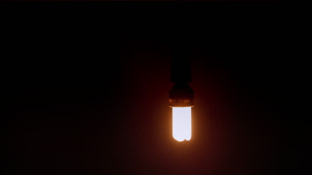 Low energy lightbulb with a soft glow gently moving side to side..