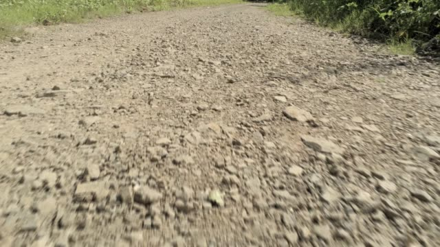 low flight forwards over a dirt road - aerial footage video