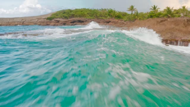Low Flight Over Water Too Close to Wave 4K Low Flight Over Turquoise Water of Tropical Beach puerto rico stock videos & royalty-free footage
