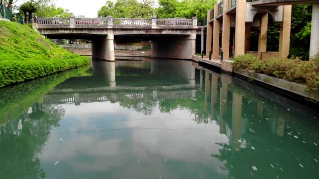 low flying drone shot along the river walk in san antonio, texas near the pearl district - san antonio texas stock videos & royalty-free footage