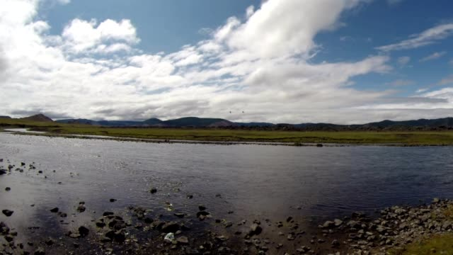 Low Mongolian Sky Over Unhurried Flow Mongolian Crystal Clear River in The Midst of a Vast Steppe video