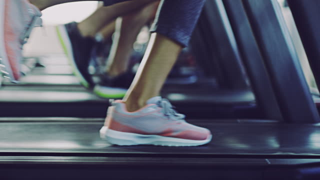 Low on impact but high on calorie burning Close-up 4k video of people working out on a treadmill at the gym health club stock videos & royalty-free footage