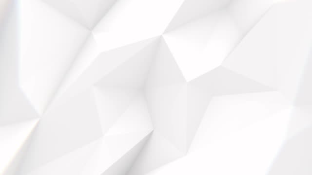 Low Poly Background Low polygonal white waving surface. Seamlessly looping video geometric background stock videos & royalty-free footage