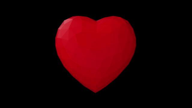vídeos de stock e filmes b-roll de low poly pulsating heart - imagem pulsante