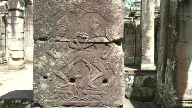 low relief of two apsara dancers at banteay kdei temple, angkor wat