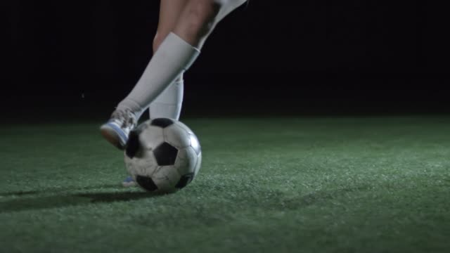 Low Section of Young Boy Dribbling Soccer Ball video