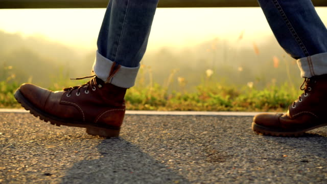 Low section view of Leather boot walking in the morning video