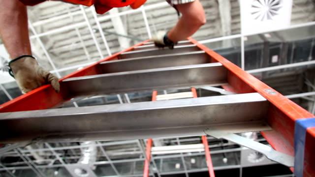 stockvideo's en b-roll-footage met low shot of man climbing ladder. - ladder