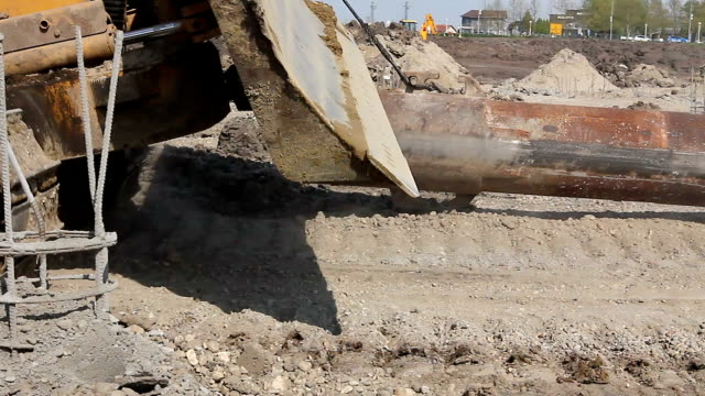 Low view on crawler who is dragging huge long pipe video