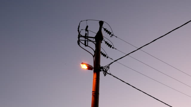 Low voltage electric pole with street lamp