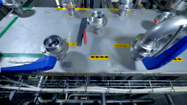 A low zoomed out view on a dairy water flow controls. video