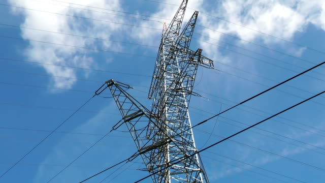 Low-angle view of electricity pylons Low-angle view of electricity pylons power supply stock videos & royalty-free footage