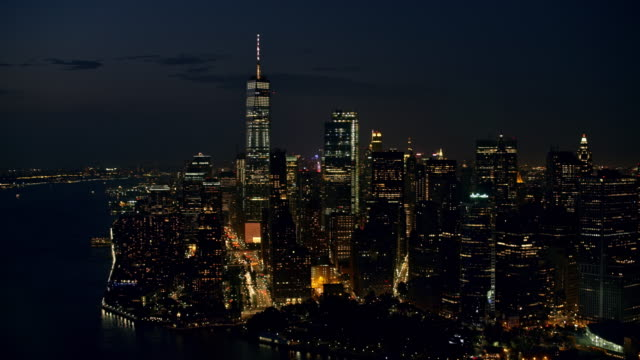 AERIAL Lower Manhattan at night with the Freedom Tower standing out in the night