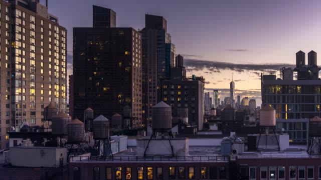 Lower Manhattan Skyline Over Midtown Buildings - Time Lapse