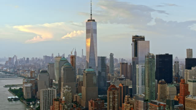 aerial lower manhattan with freedom tower reflecting the clouds - american architecture stock videos & royalty-free footage