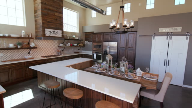 lowering on modern kitchen island with stools - kitchen situations video stock e b–roll