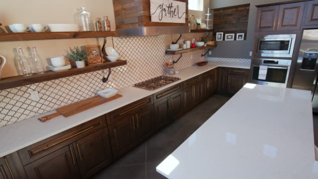 lowering on sink in large modern rustic kitchen - kitchen situations video stock e b–roll