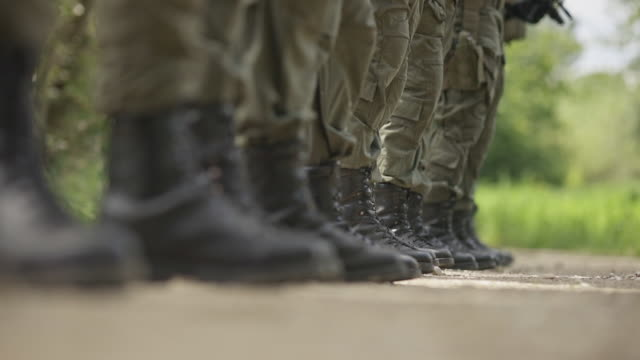 Low-section of military soldiers standing in line 4k stock video