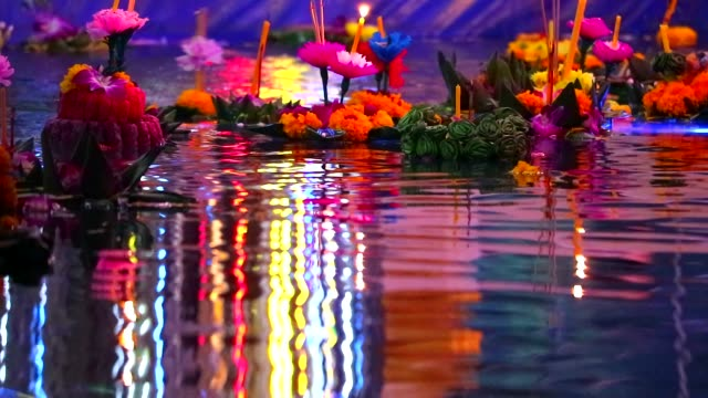 Loy Kratong Festival reflection light on water surface