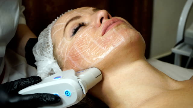 Lubrication lifting Non-surgical face lifting. Lubrication lifting ultrasonic. Facelift. Process of rejuvenation. Spa treatment. Hardware cosmetology. Treatment of facial skin by ultrasound. beautician stock videos & royalty-free footage
