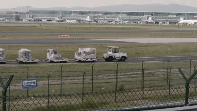 luggage cart, frankfurt airport luggage cart, frankfurt airport airfield stock videos & royalty-free footage