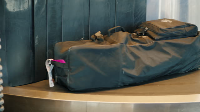 Luggage of passengers is moved along the transport belt video