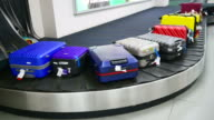 istock Luggage on baggage conveyor belt at airport 1193899266