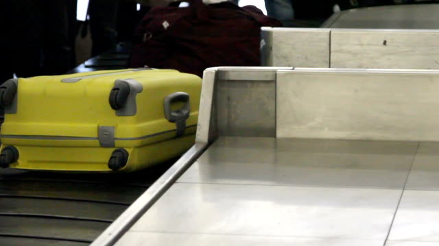 Luggage travels on a conveyor belt at the airport video