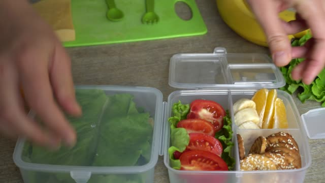 vídeos de stock e filmes b-roll de lunch box for kids and adults - lanche