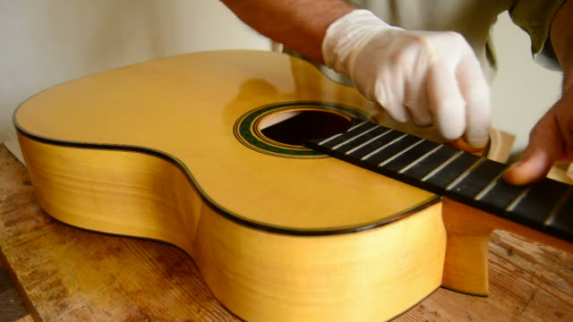 Luthier varnishing a flamenco guitar video
