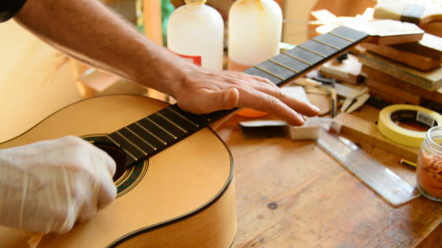 Luthier varnishing a guitar video
