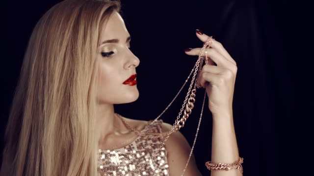 Luxurious girl and gold jewelry.