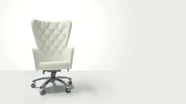 vídeos de stock e filmes b-roll de luxurious leather business chair rotating - chair