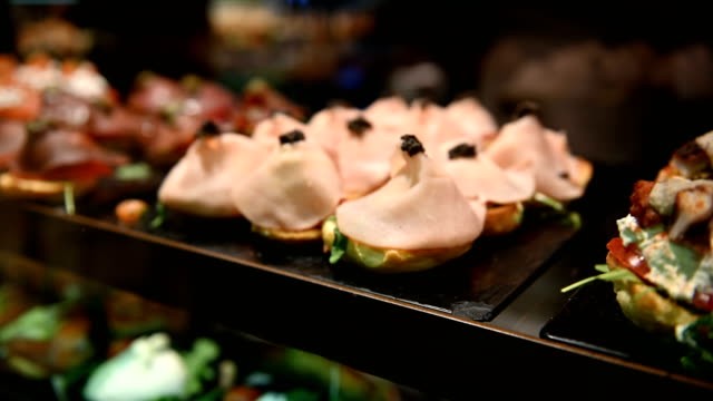 Luxurious selection of tapas. traditional small portion snacks in Spain. in San Miguel tapas bar