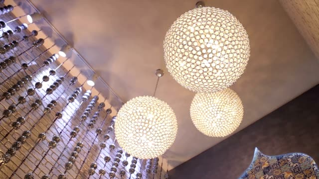 Luxury big round chandeliers. Luxury big round chandeliers. For the ceiling of the restaurant attached three huge chandeliers. Chandeliers look Luxuriously and give the atmosphere an expensive east. household fixture stock videos & royalty-free footage