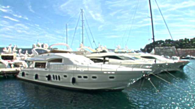 HD: Luxury Boats In Monaco HD1080i: Luxury boats moored in Monaco marina. Panoramic View. Monaco. Europe.  monte carlo stock videos & royalty-free footage