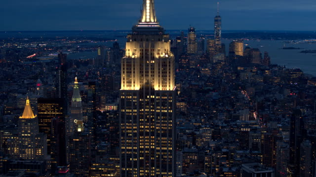 AERIAL CLOSE UP: Luxury condos behind Empire State Building glowing in the dark video