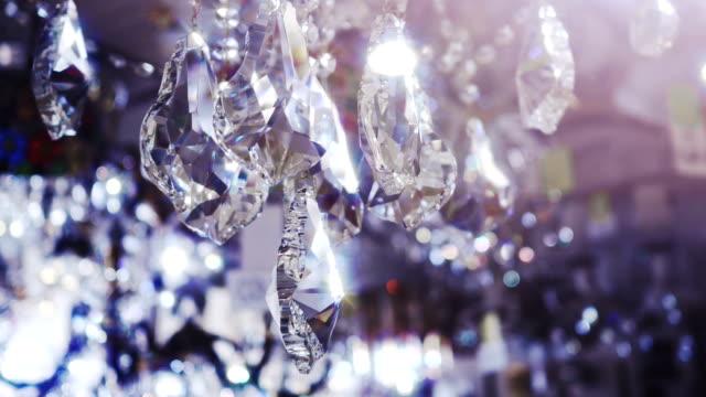 luxury crystals of a classic chandelier. - avize aydınlatma ürünleri stok videoları ve detay görüntü çekimi