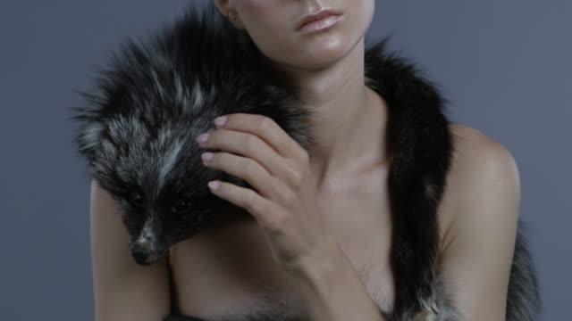 luxury fashion model in silver fox fur touches fur. fashion video. - clavicola video stock e b–roll